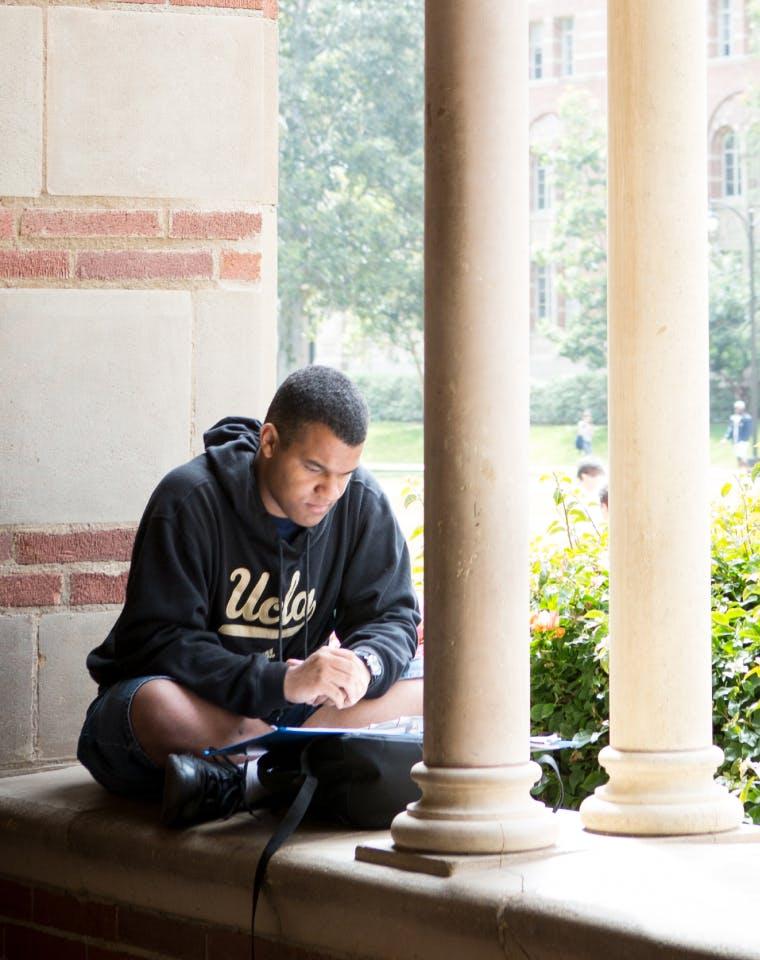 student sitting on a ledge
