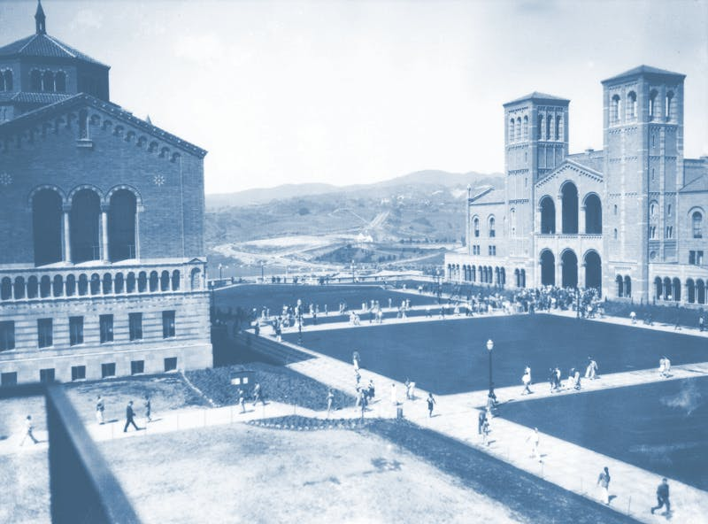 Blue tinted vintage photo of Royce Hall and Powell Library