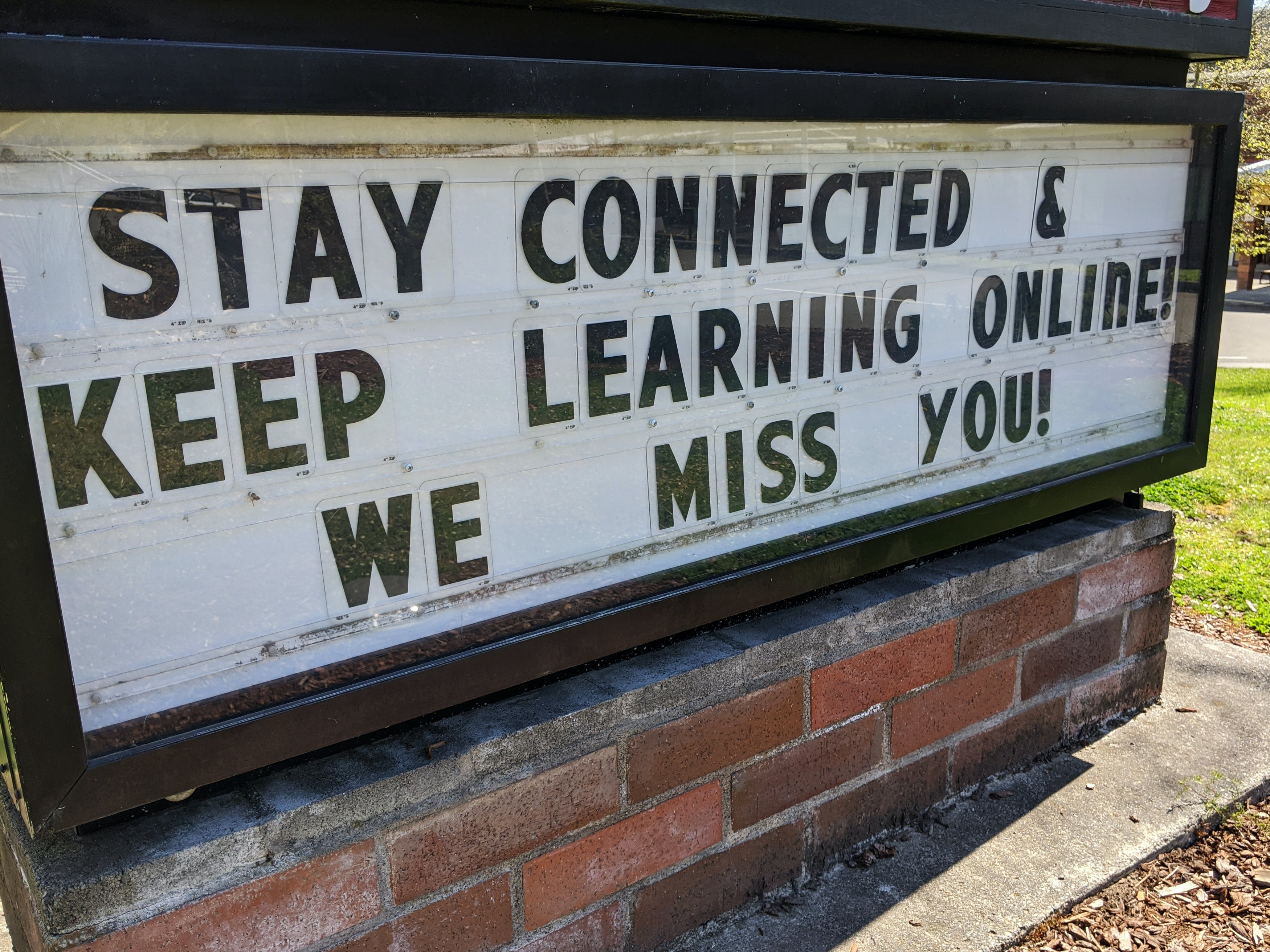 """Marquis sign """"Staying connected and keep learning online! We miss you!"""""""