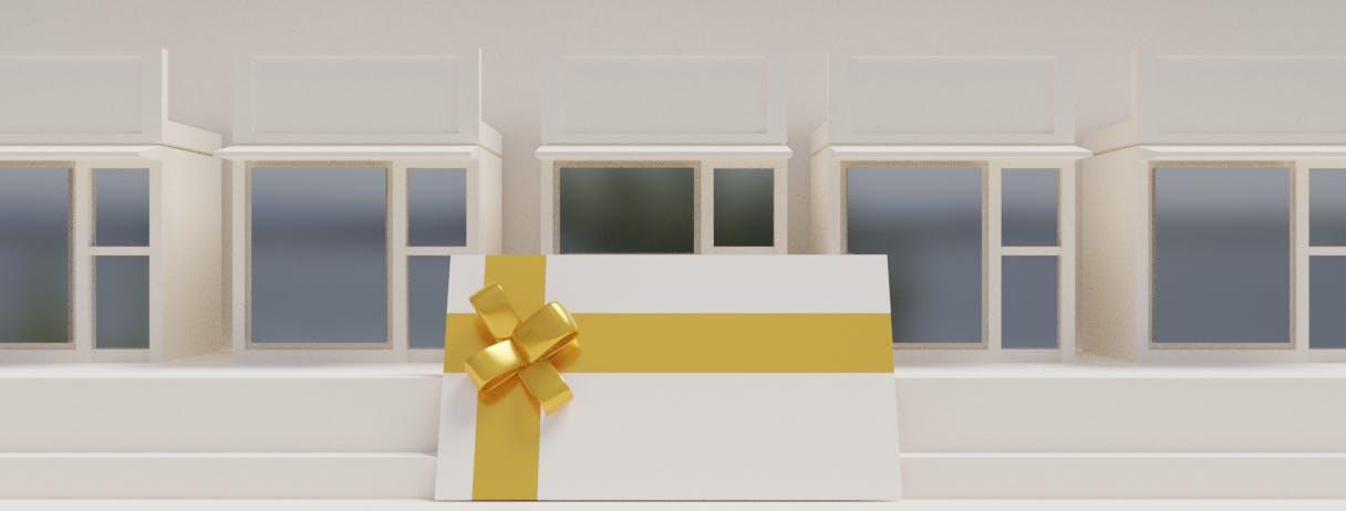 image illustrant une carte cadeau multi enseigne devant plusieurs magasins