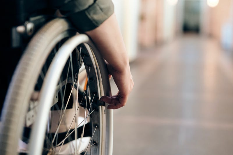 wheelchair user in corridor