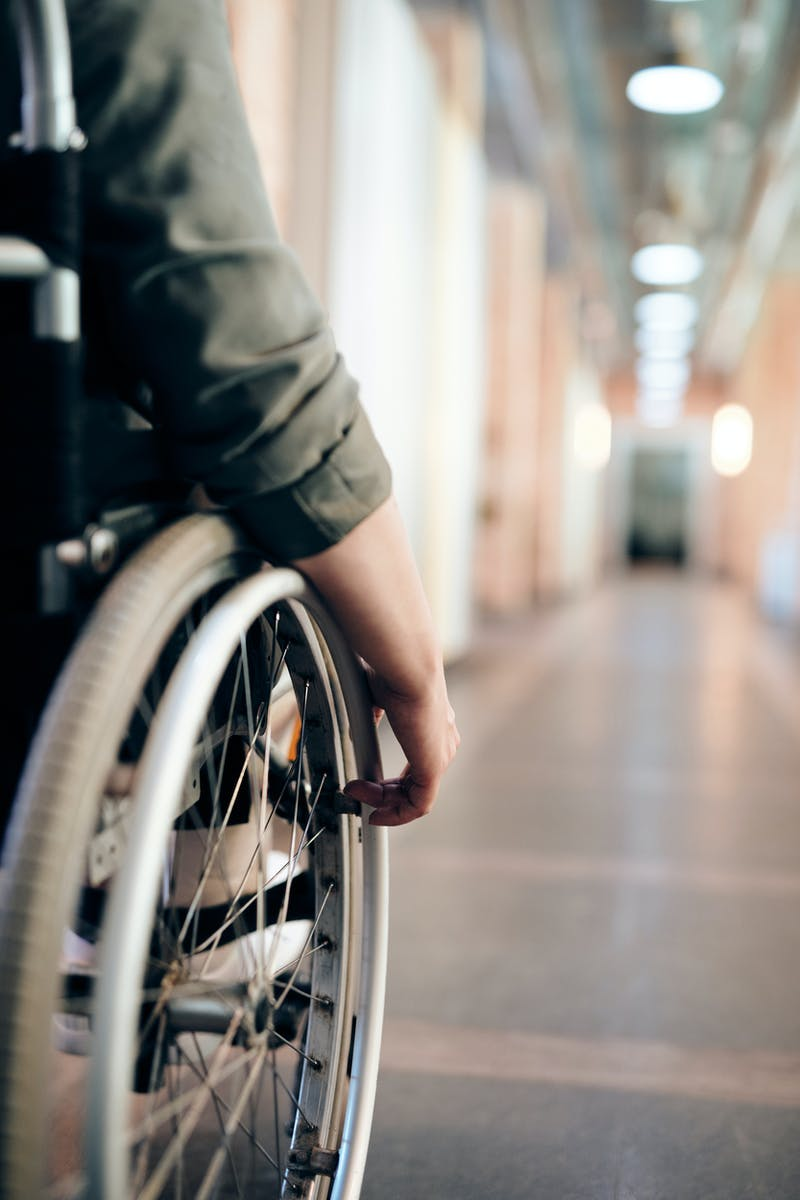 Wheelchair user in corridor