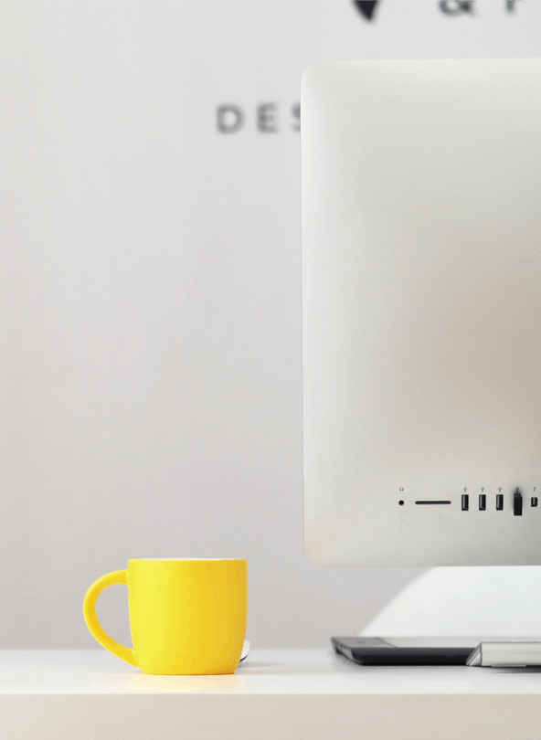 Mug next to a computer screen