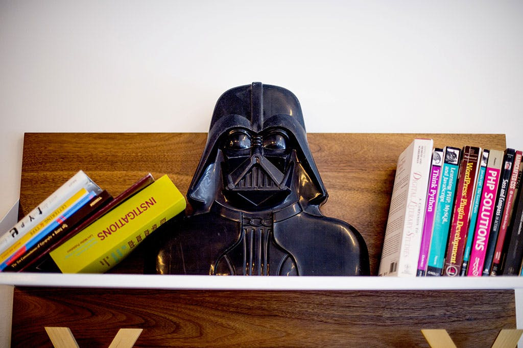 Darth Vader on a bookshelf