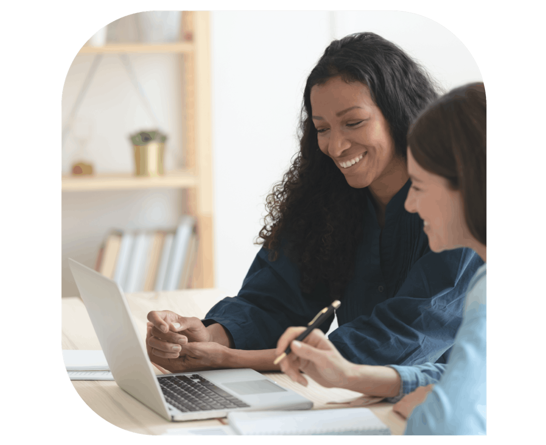 Women looking at the computer and smiling