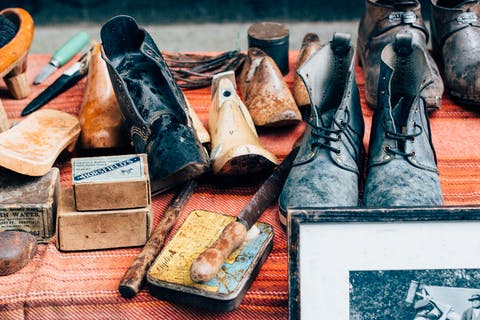 assortment of vintage shoes and shoe making supplies
