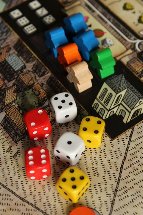 Assorted board game pieces