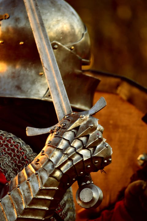 knight in armour holding sword