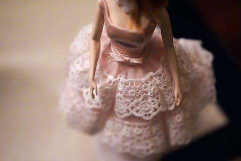 body of Barbie in pink dress