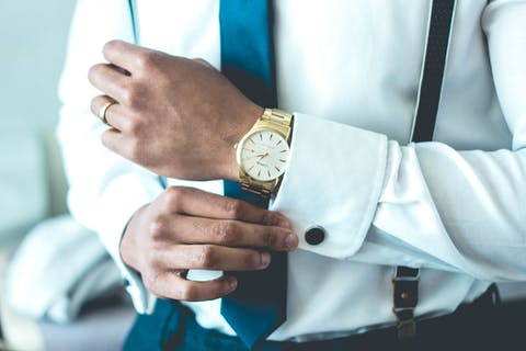 man wearing golden watch
