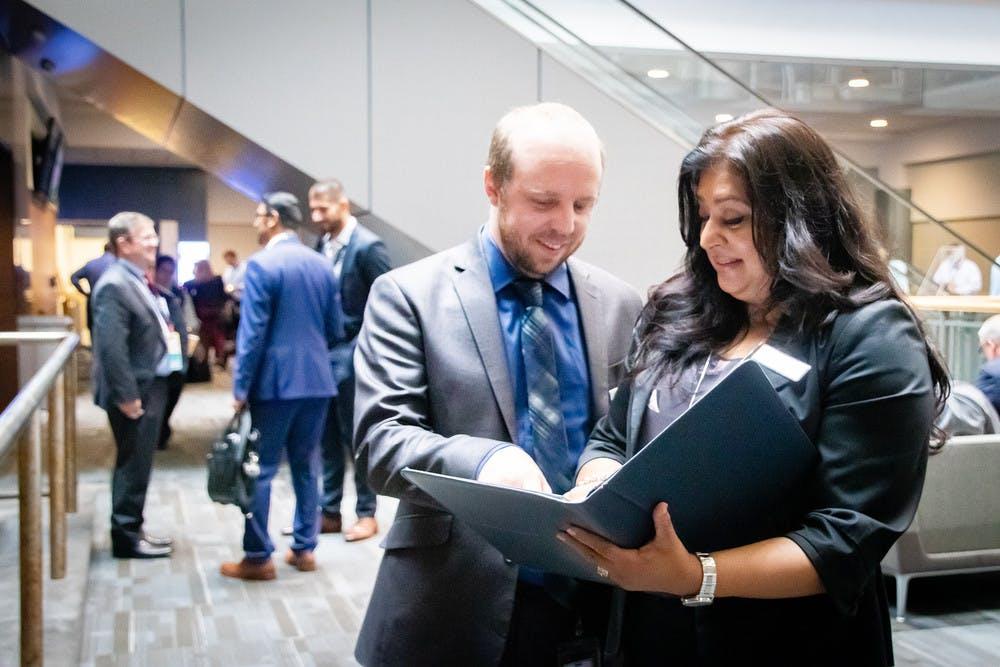 Rubina working alongside clients