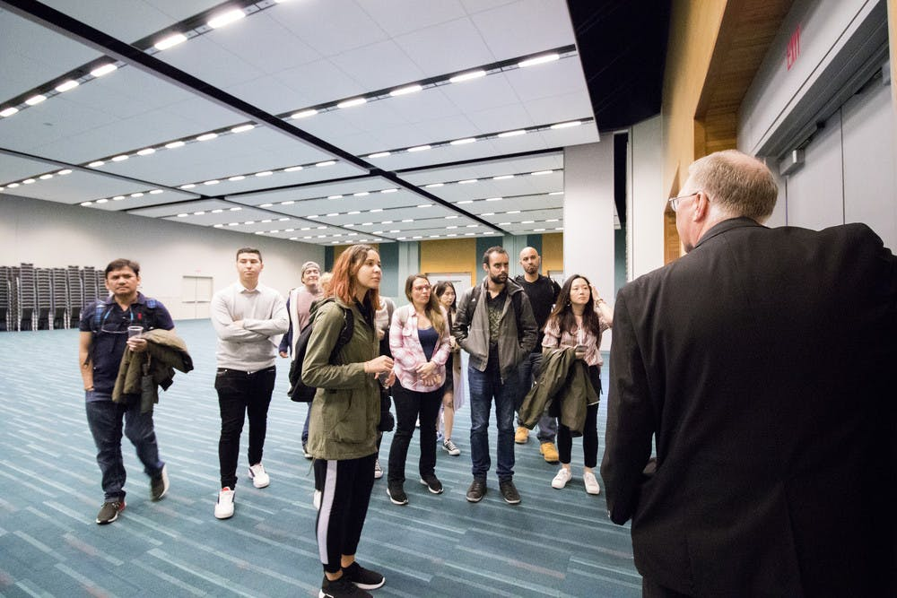 Rod MacLean, Facilities Assistant describes the functionality of the meeting rooms at the Vancouver Convention Centre