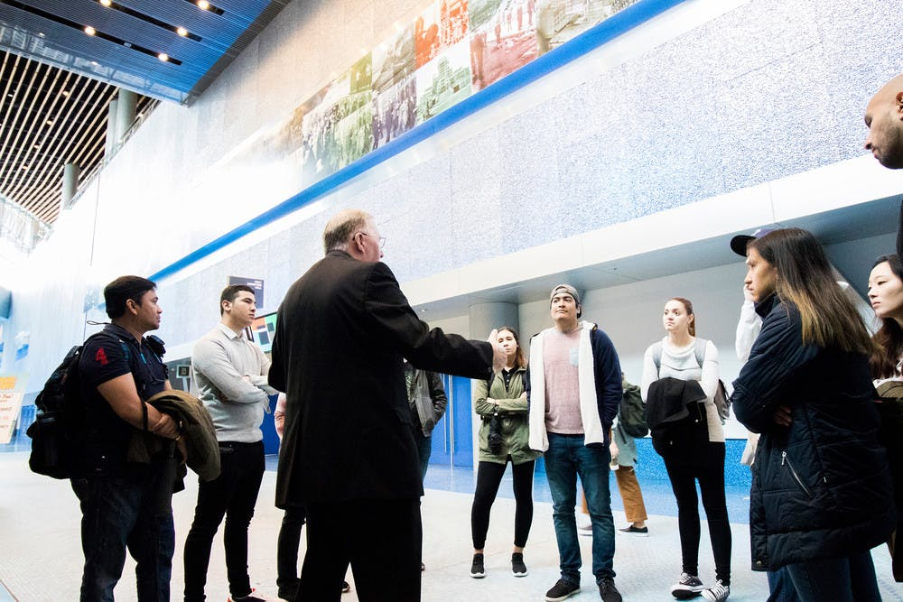 Rod MacLean, Facilities Assistant, leads a public tour through the Vancouver Convention Centre's Exhibition level