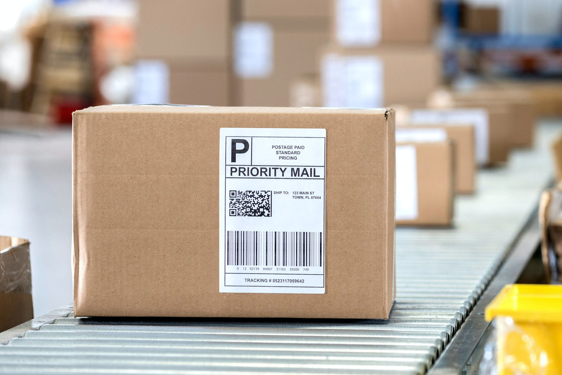 A package with address label on a conveyor belt.