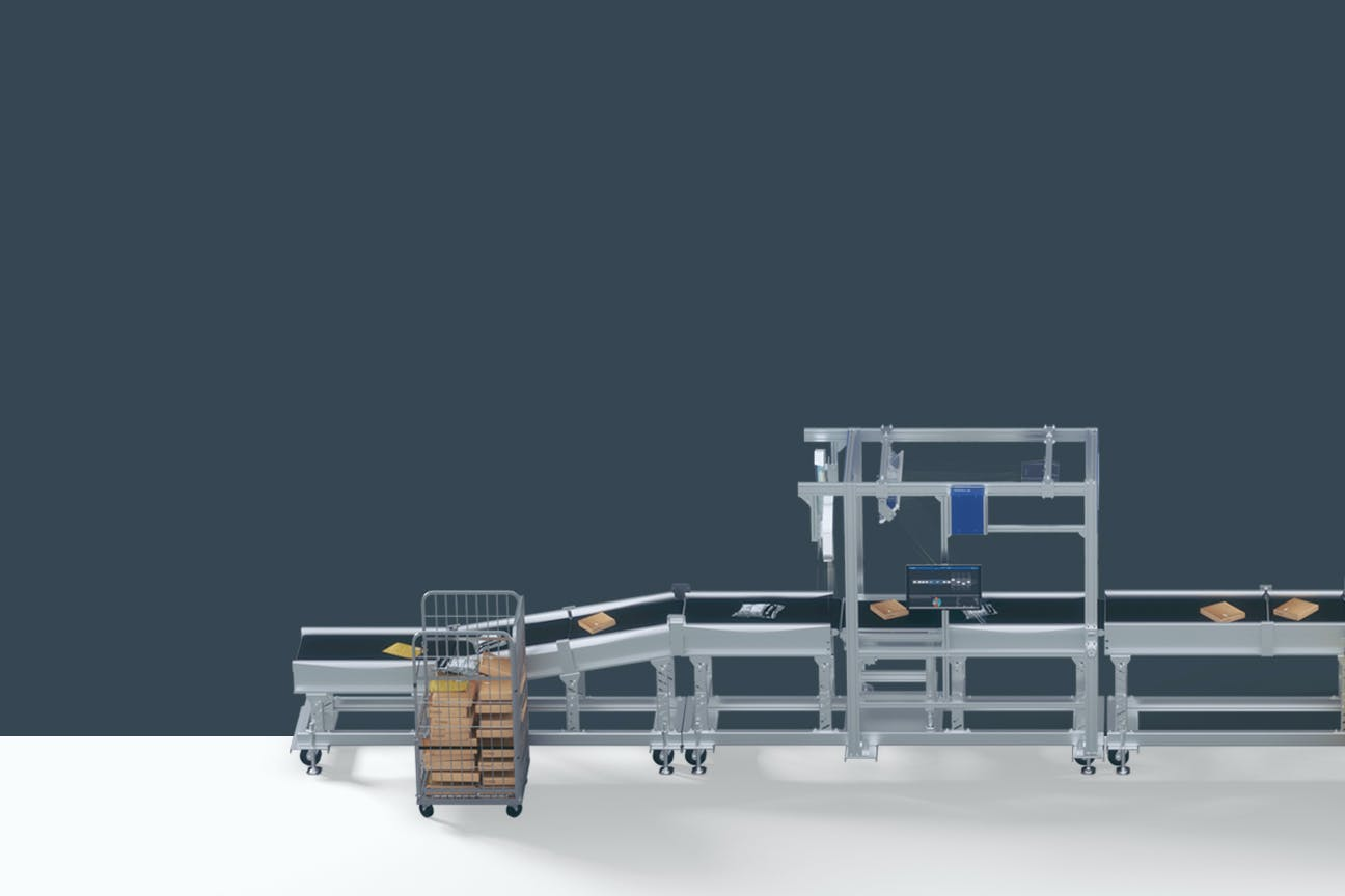 An automated complete solution for sorting shipments from VITRONIC in front of a gray background