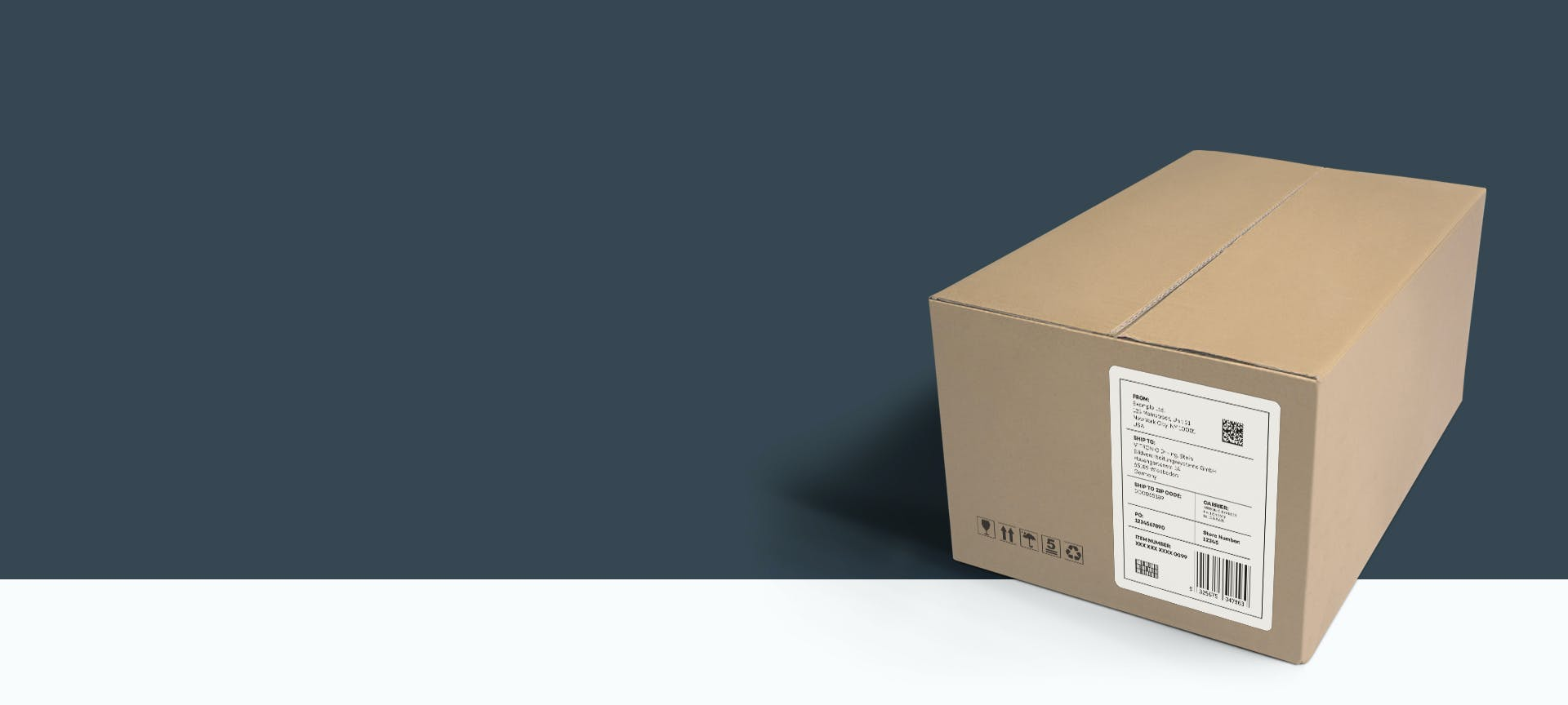 A package with an address label in front of a grey background