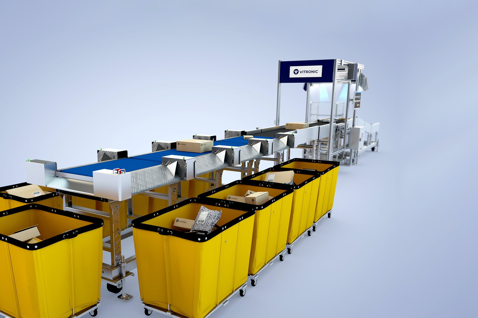 Packages run over a conveyor belt and are sorted into yellow bins.