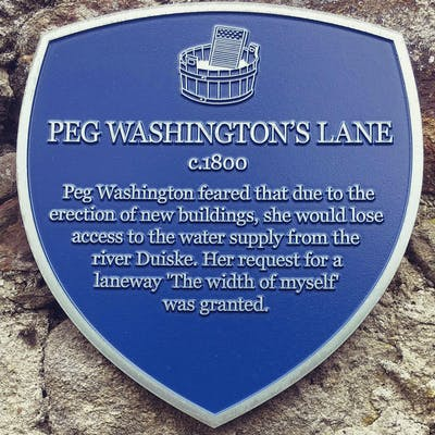 Plaque that describes how Peg Washingtons Lane came to be.