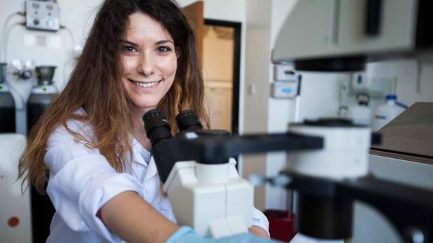 Female scientist with scientific equipment
