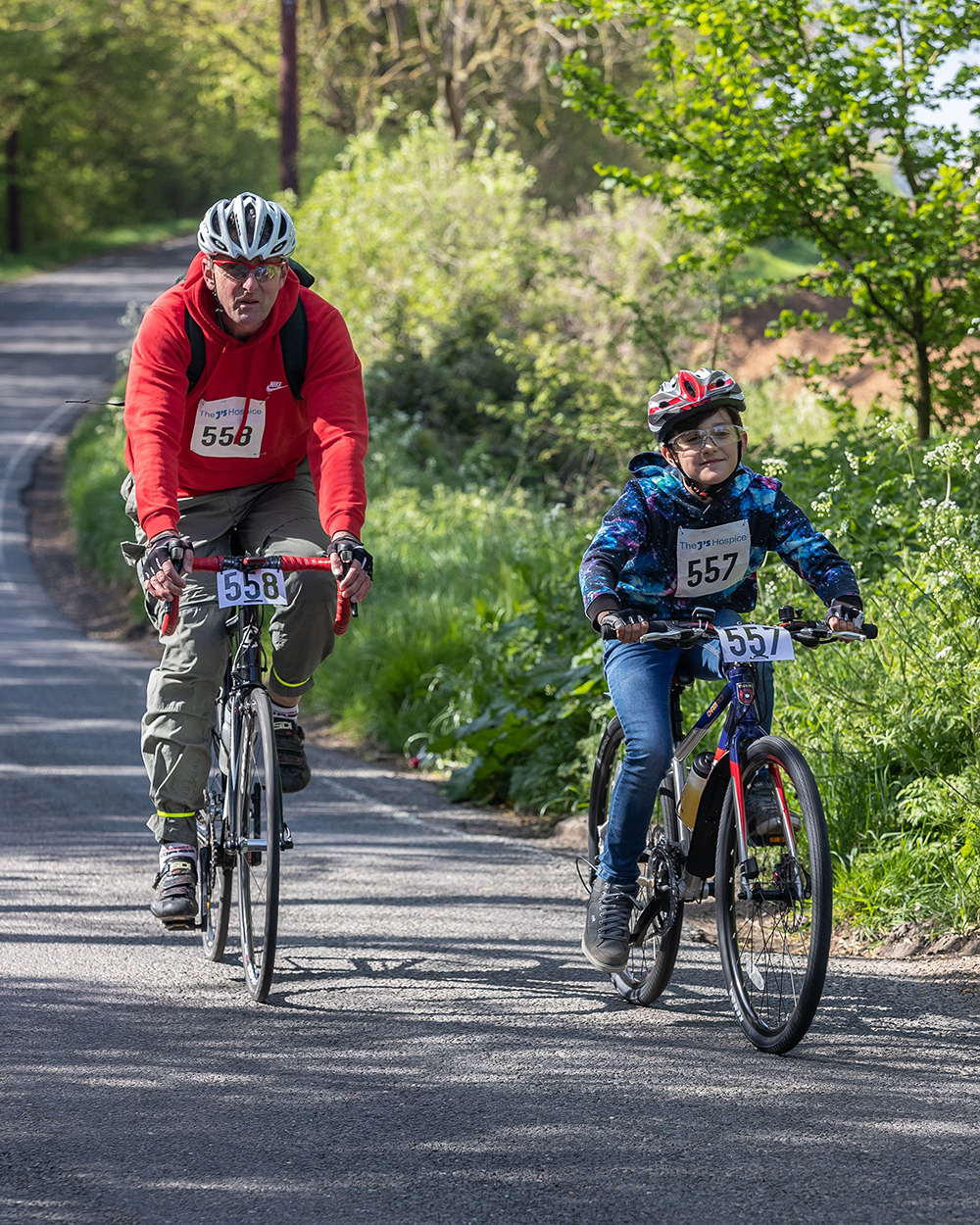 Man and boy cycling for Havens Hospices