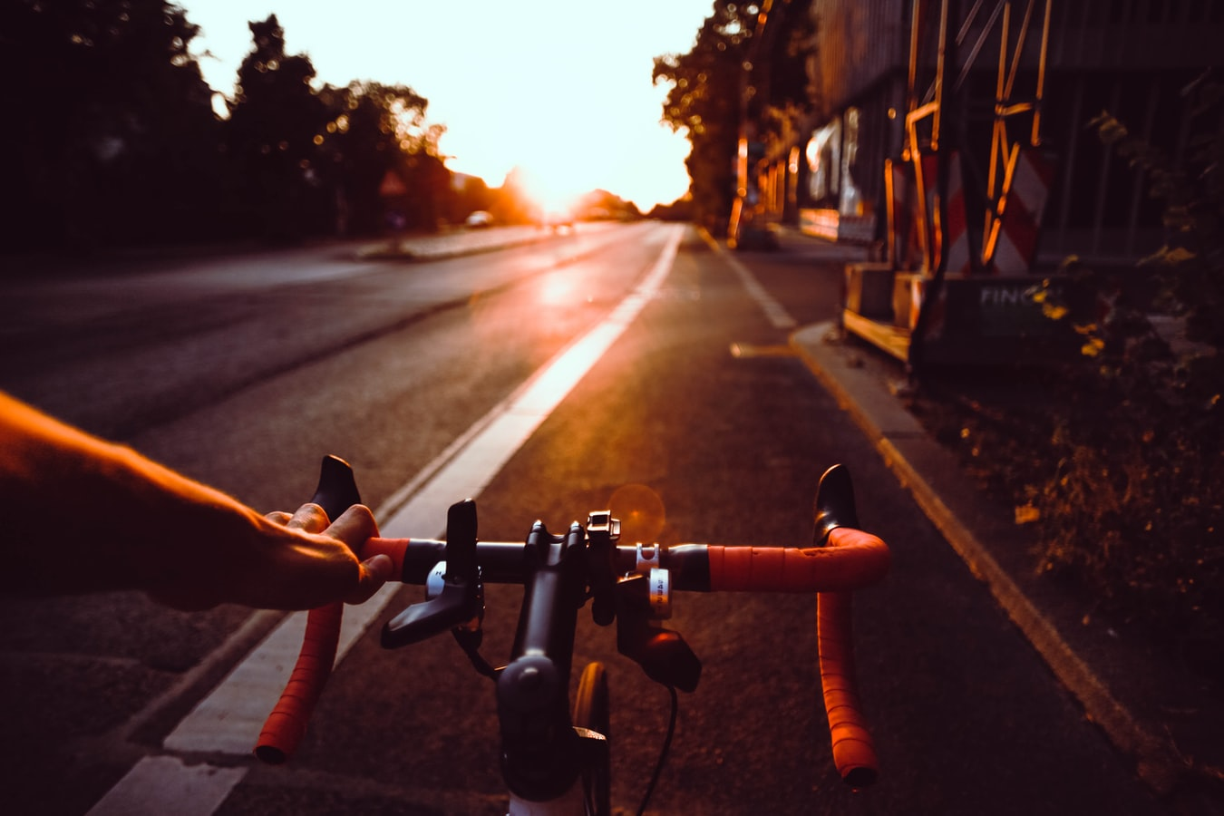 Cycling into the sunset - the view of the road from behind the handle bars.