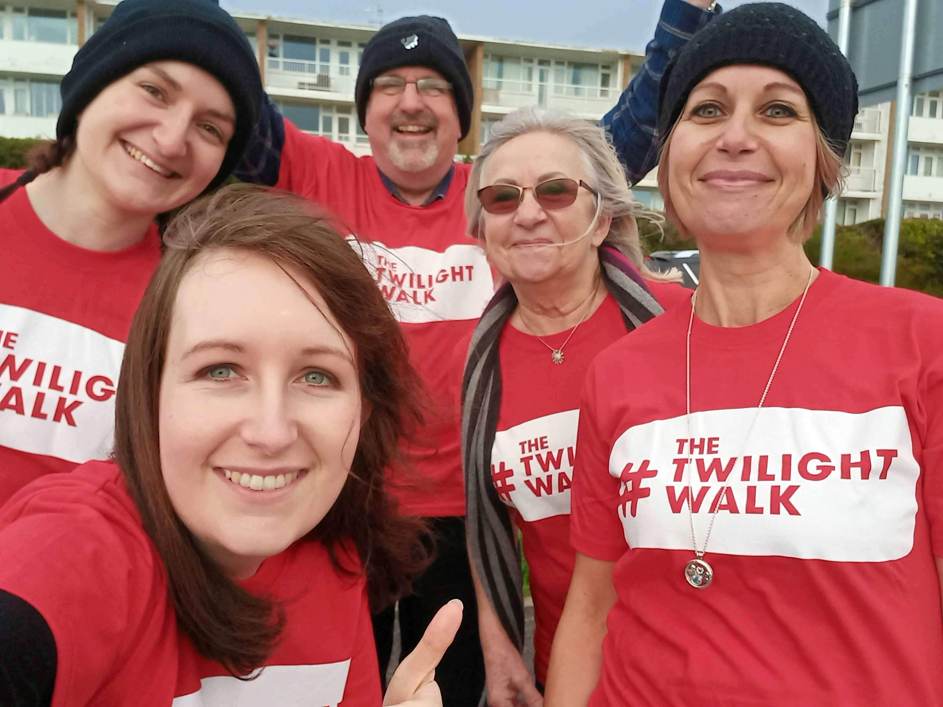 Group selfie of five people taking part in the Twilight Walk together.