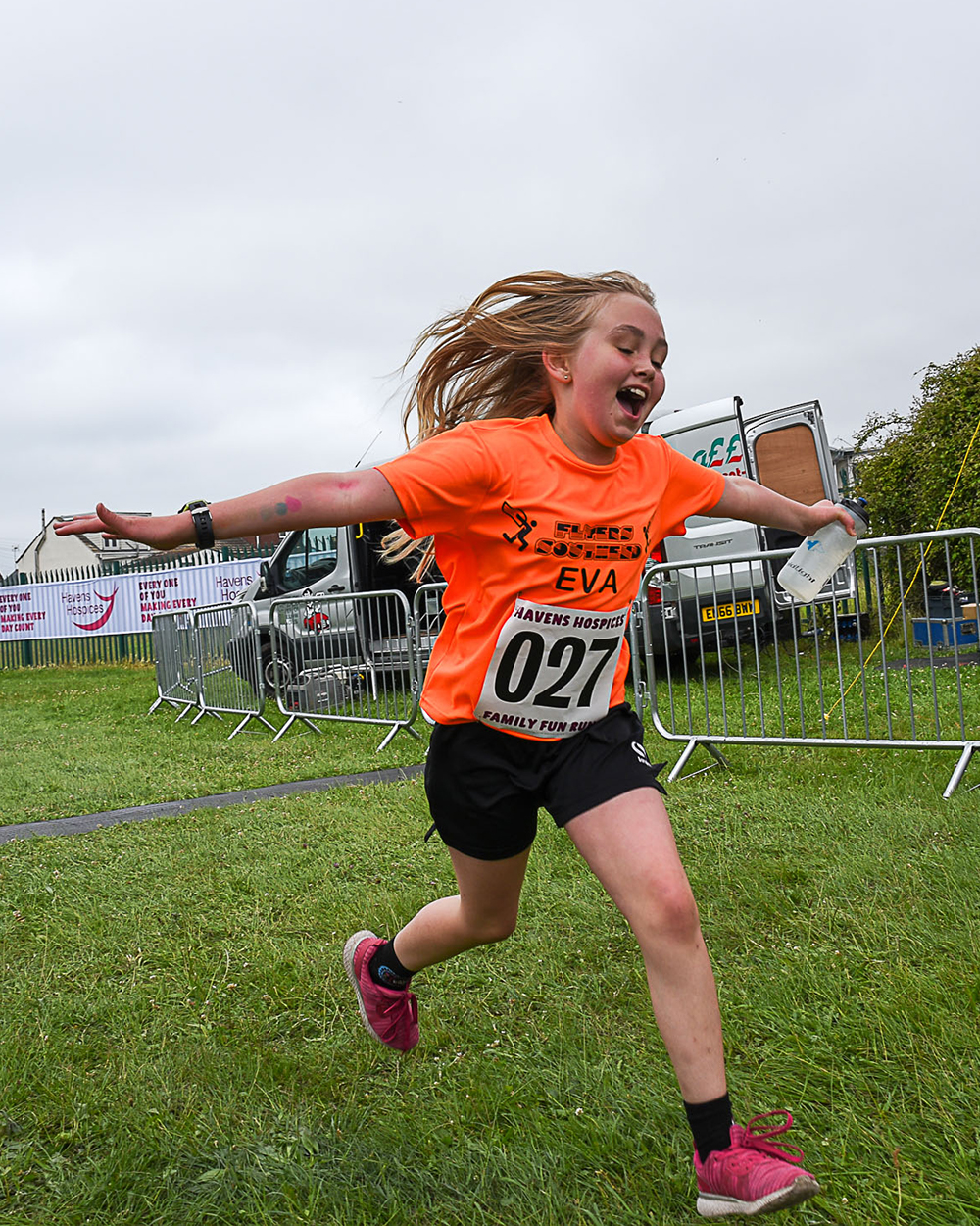 Girl running for Havens Hospices at family fun run