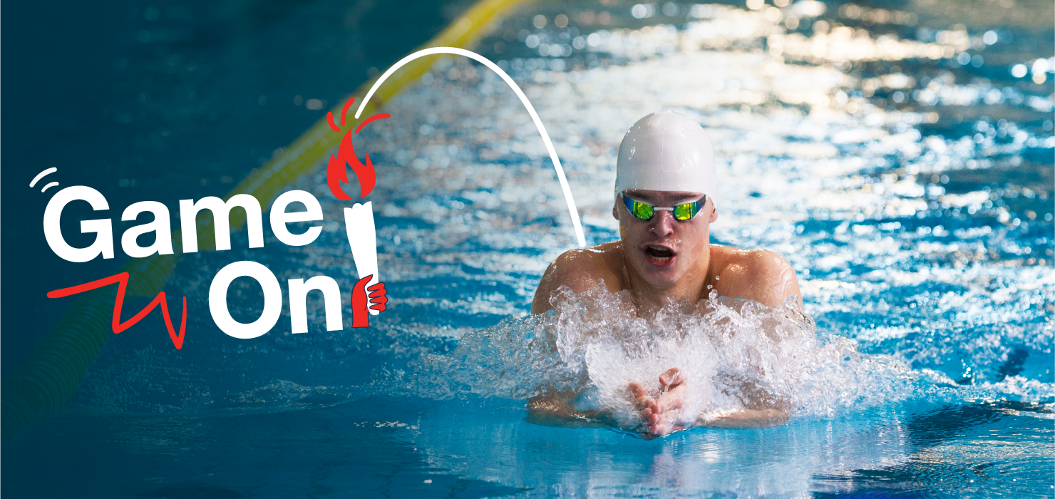 Person swimming in a pool with 'Game On' logo to the right