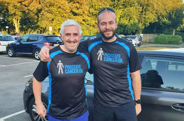 Two men wearing Prostate Cancer UK exercise t-shirts