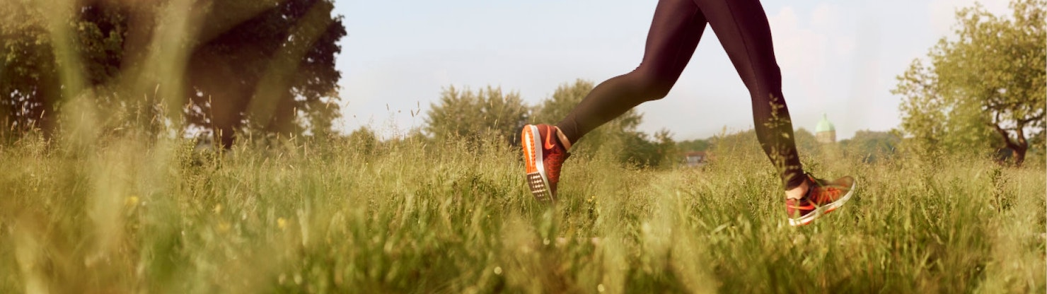 Person running in long grass