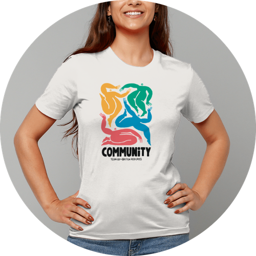 Woman wearing white t-shirt with multicoloured design on front.