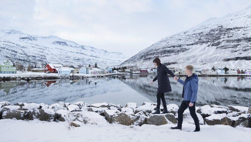 People walking in snow in Seydisfjordur town