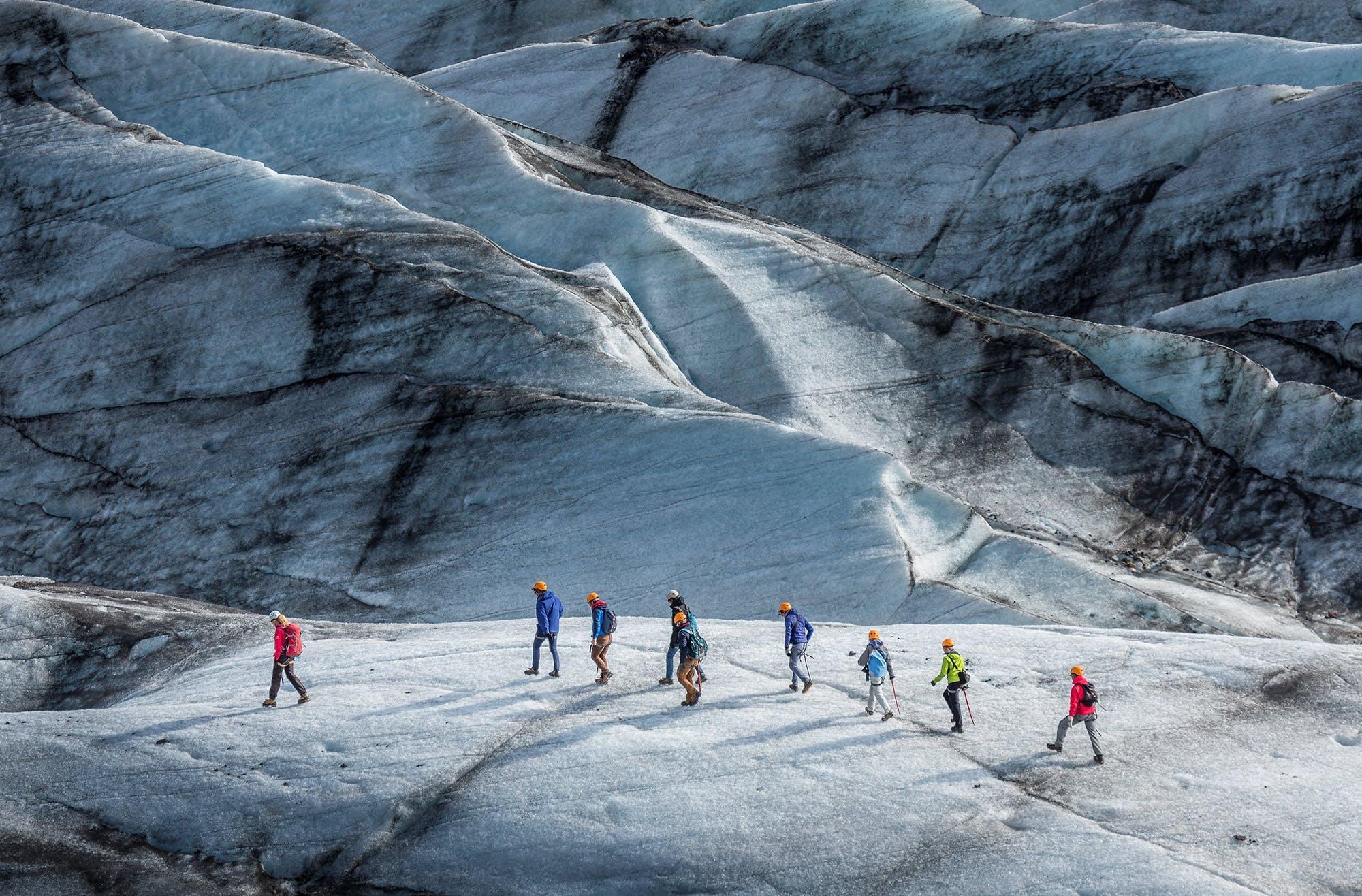 People hiking on Svínafellsjökull glacier