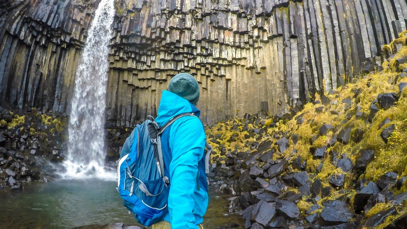 Man viewing a a waterfall in Iceland