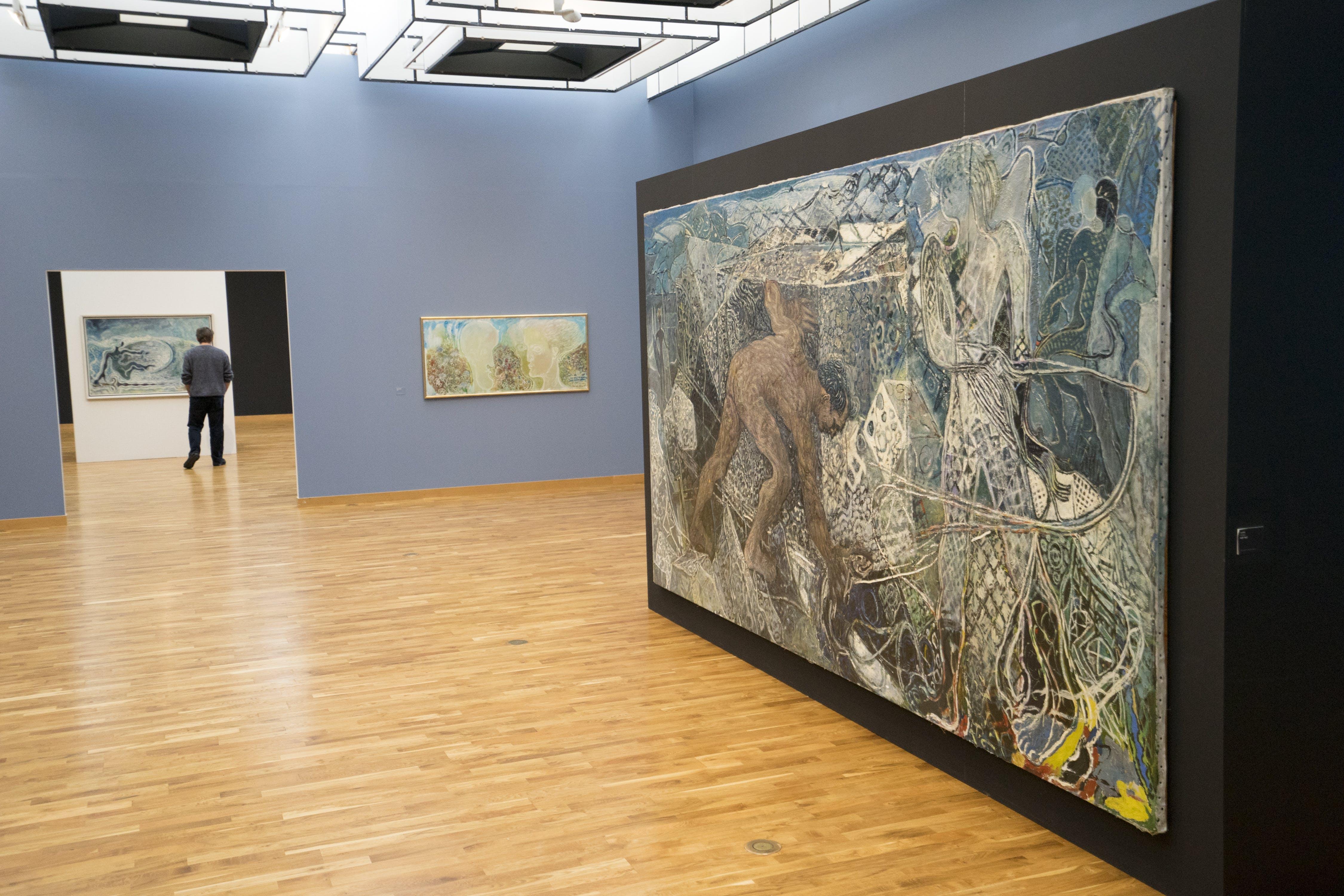 A man visiting an art gallery