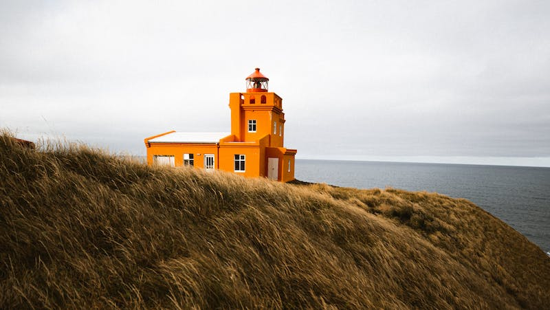 An orange lighthouse in North Iceland.