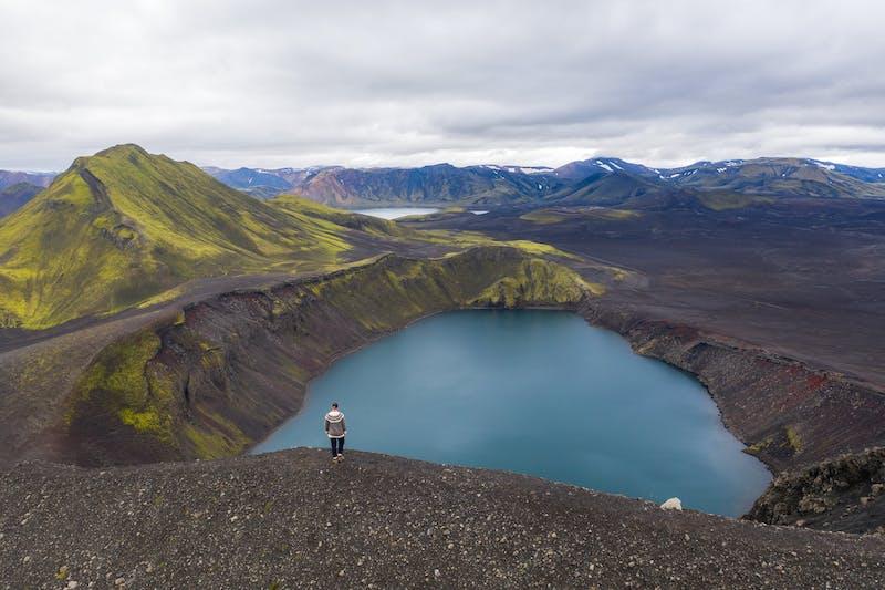 A man viewing a crater at Landmannalaugar
