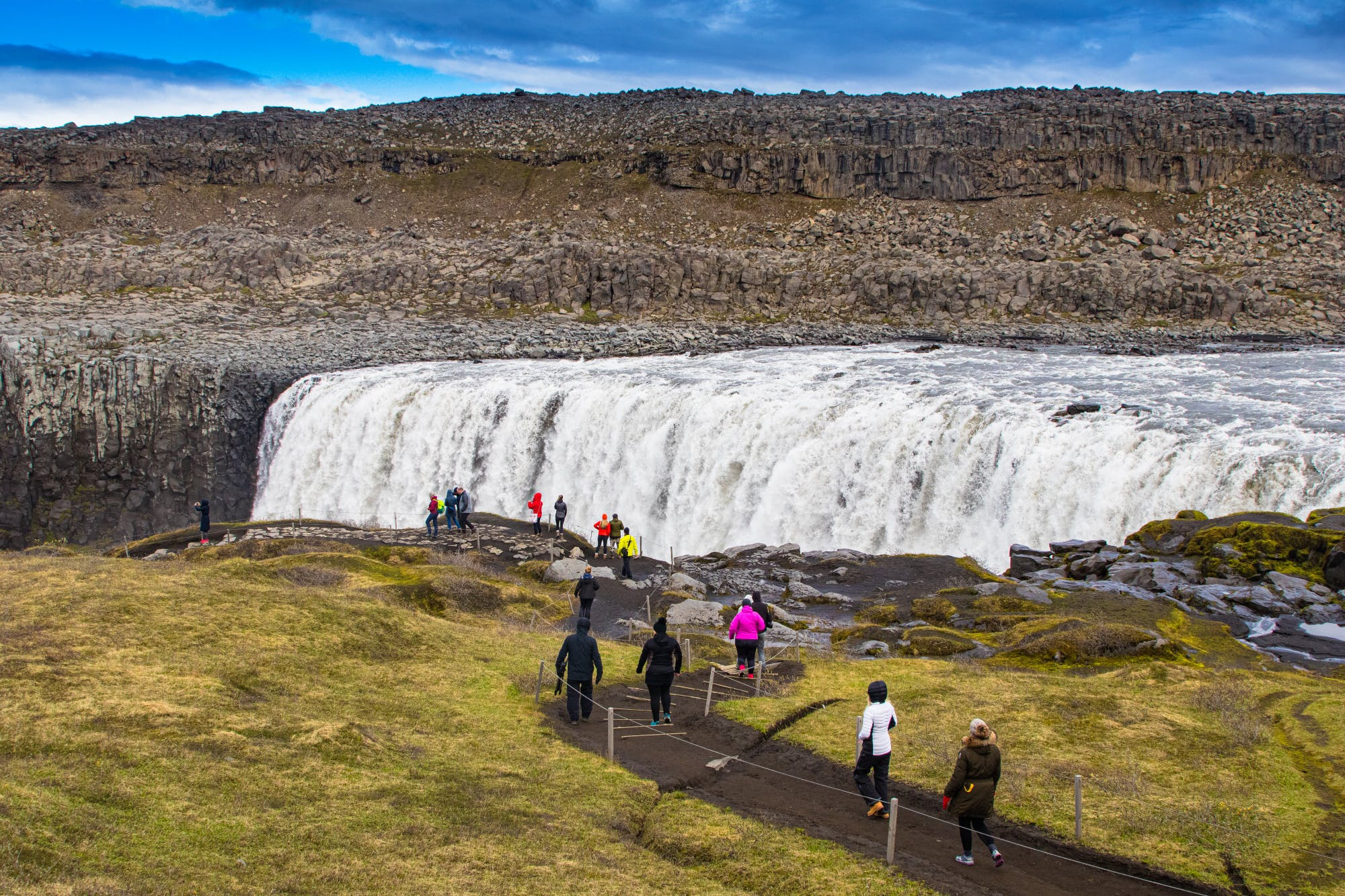 People at Dettifoss waterfall