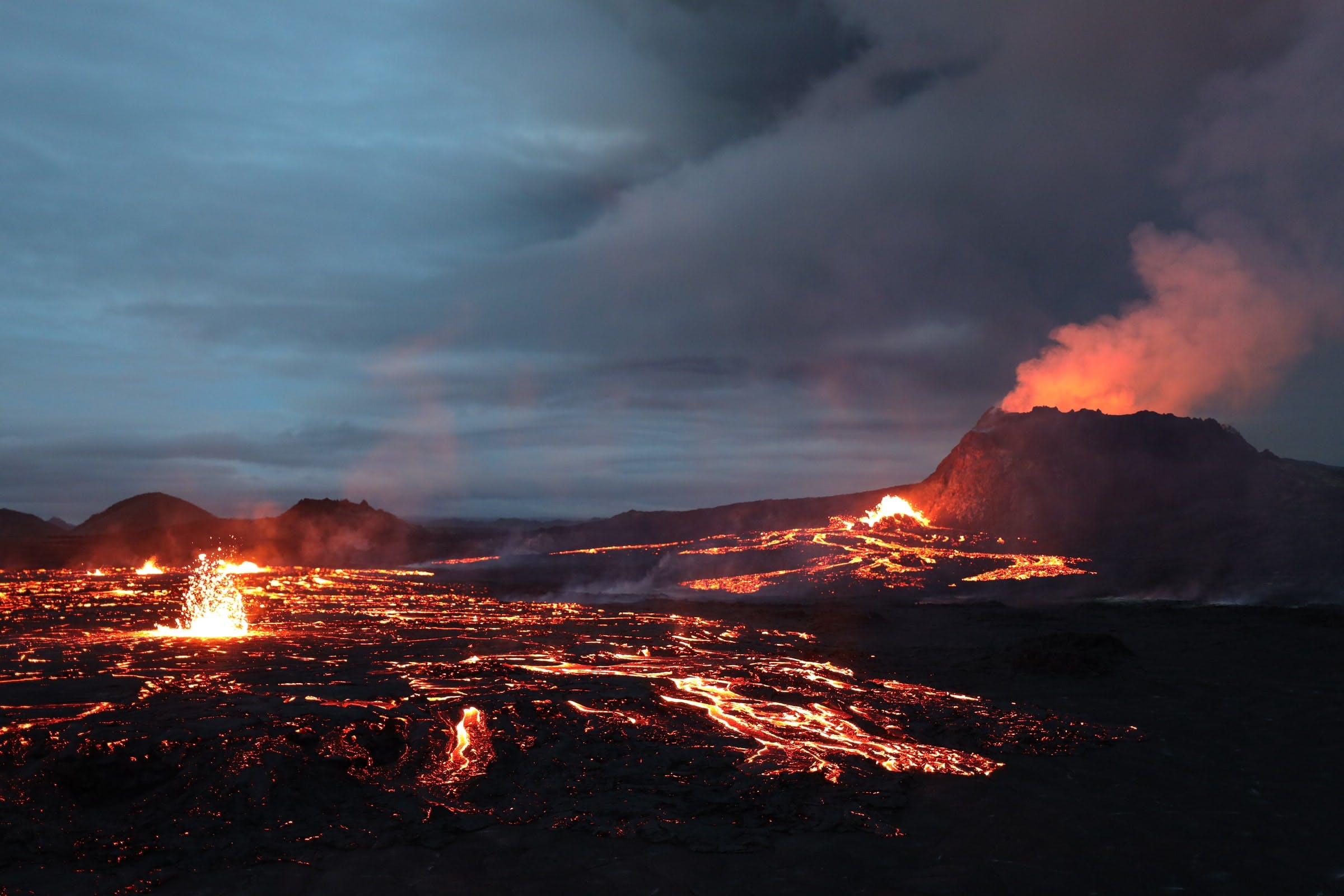 Erupting crater and flowing lava