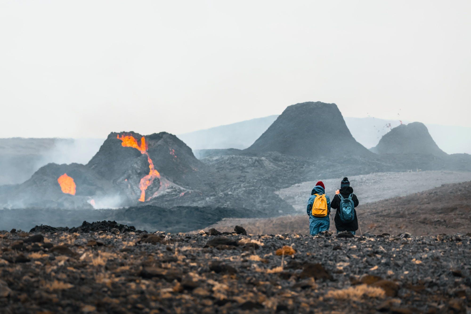 A couple hiking to Geldingadalir volcano