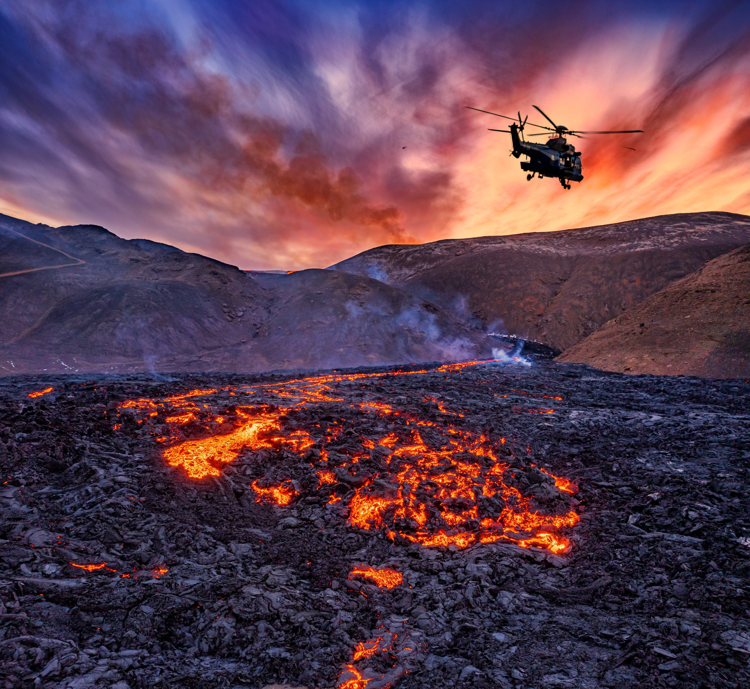 Helicopter flying over Fagradalsfjall volcano in Iceland