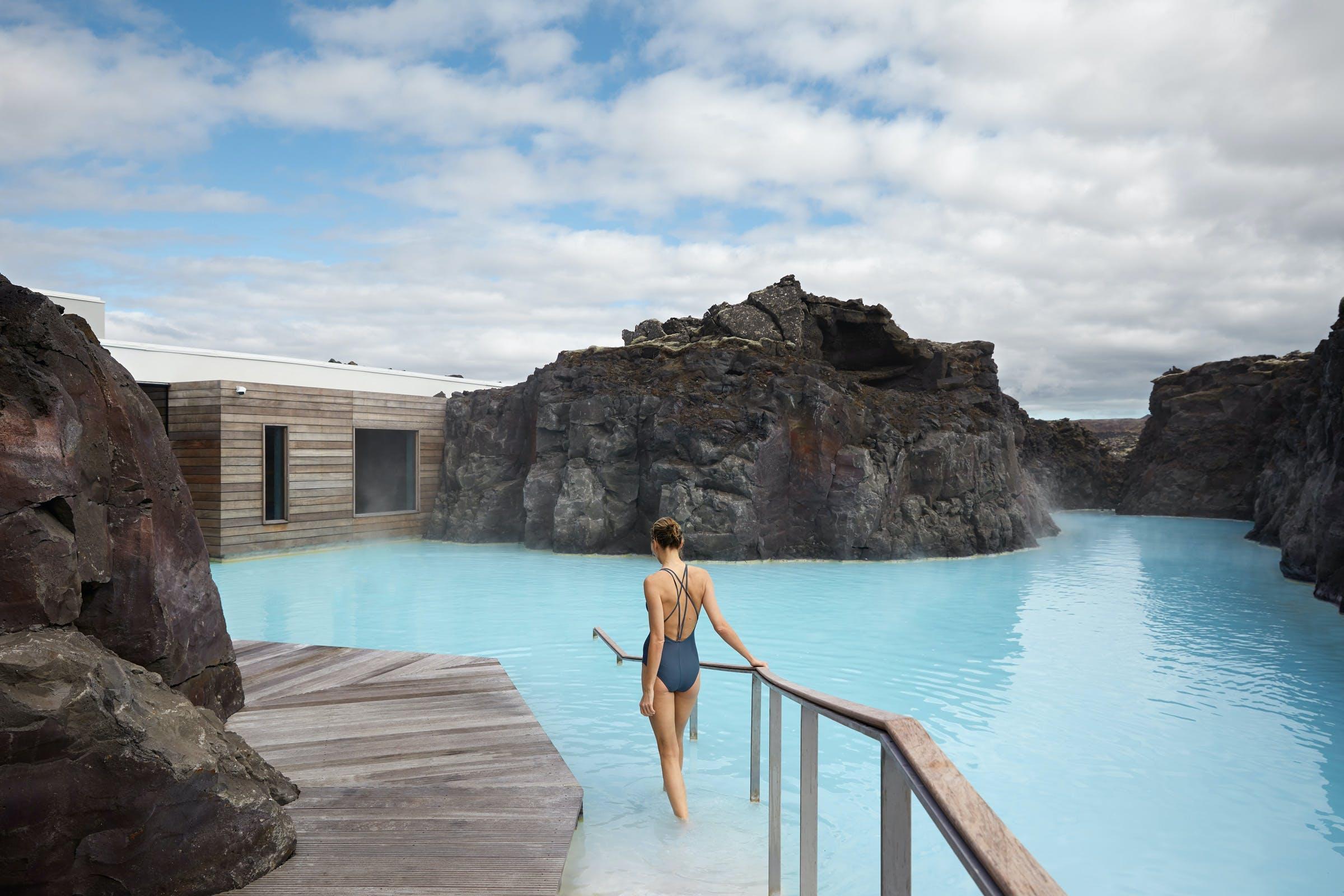 A woman bathing in the Blue lagoon retreat