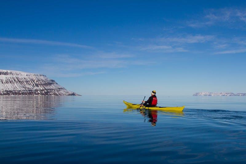 A man sailing on a kayak