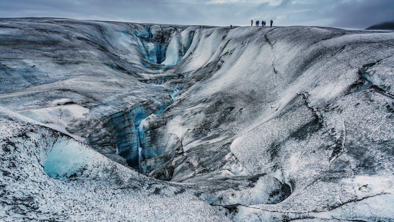 People walking on Vatnajokull glacier
