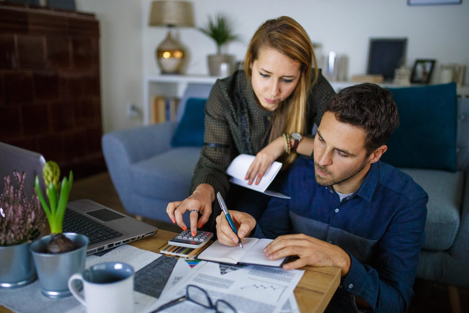 Couple calculating a price for their first house