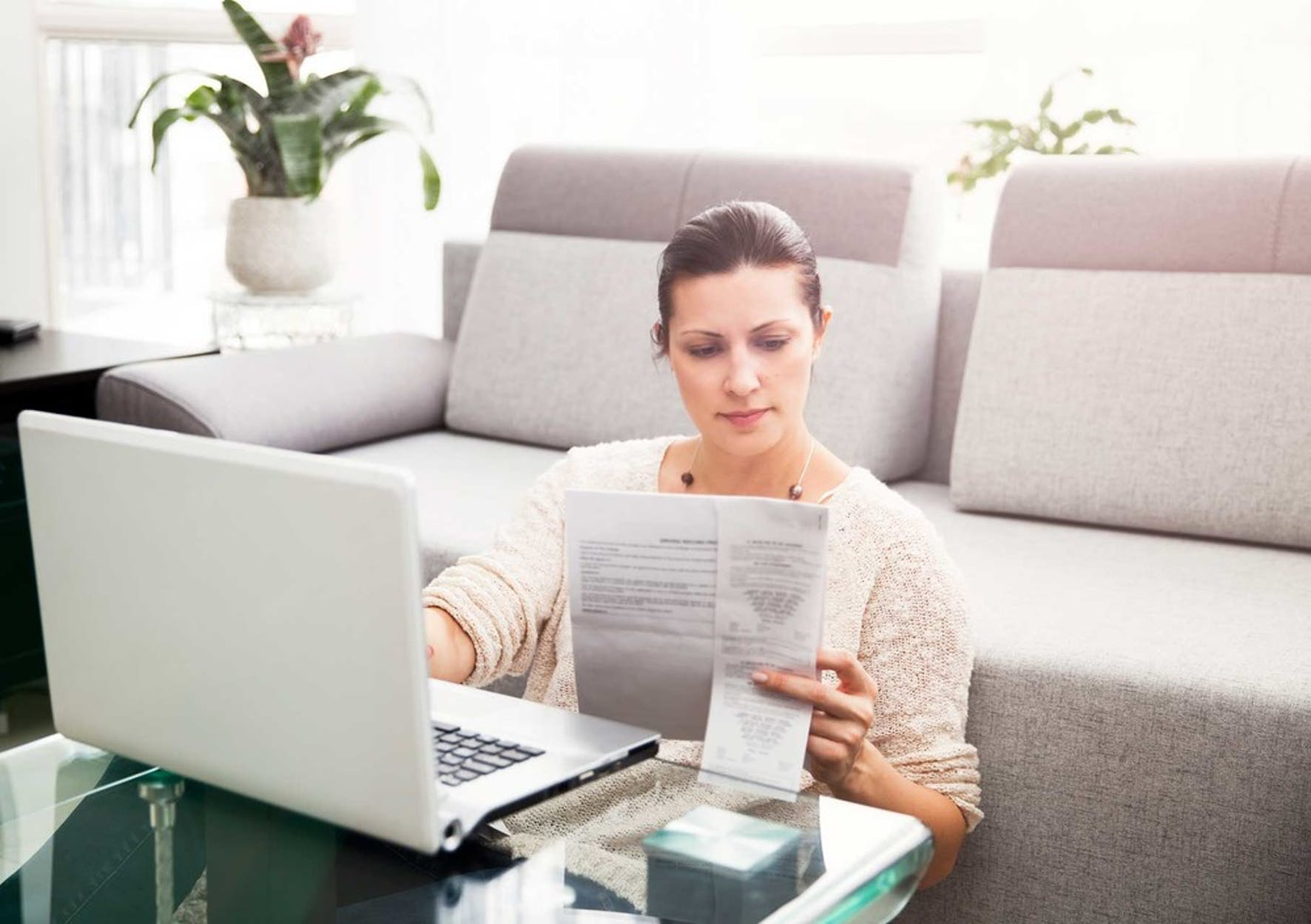 Small business owner filing her tax return on her own from home