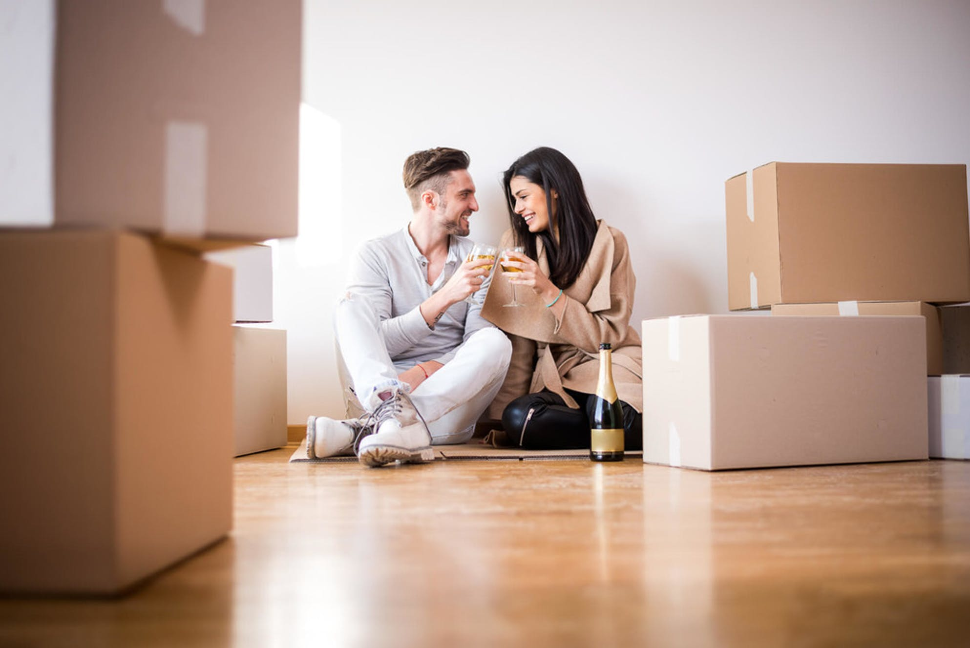 Couple celebrating a purchase of their first home