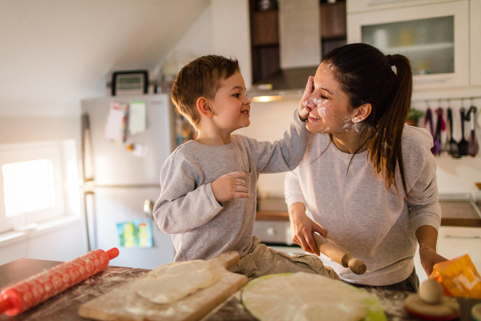 Child and mother having fun in newly purchased house