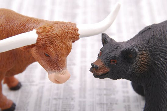6 Options trading strategies: Toy bull and toy bear confronting each other
