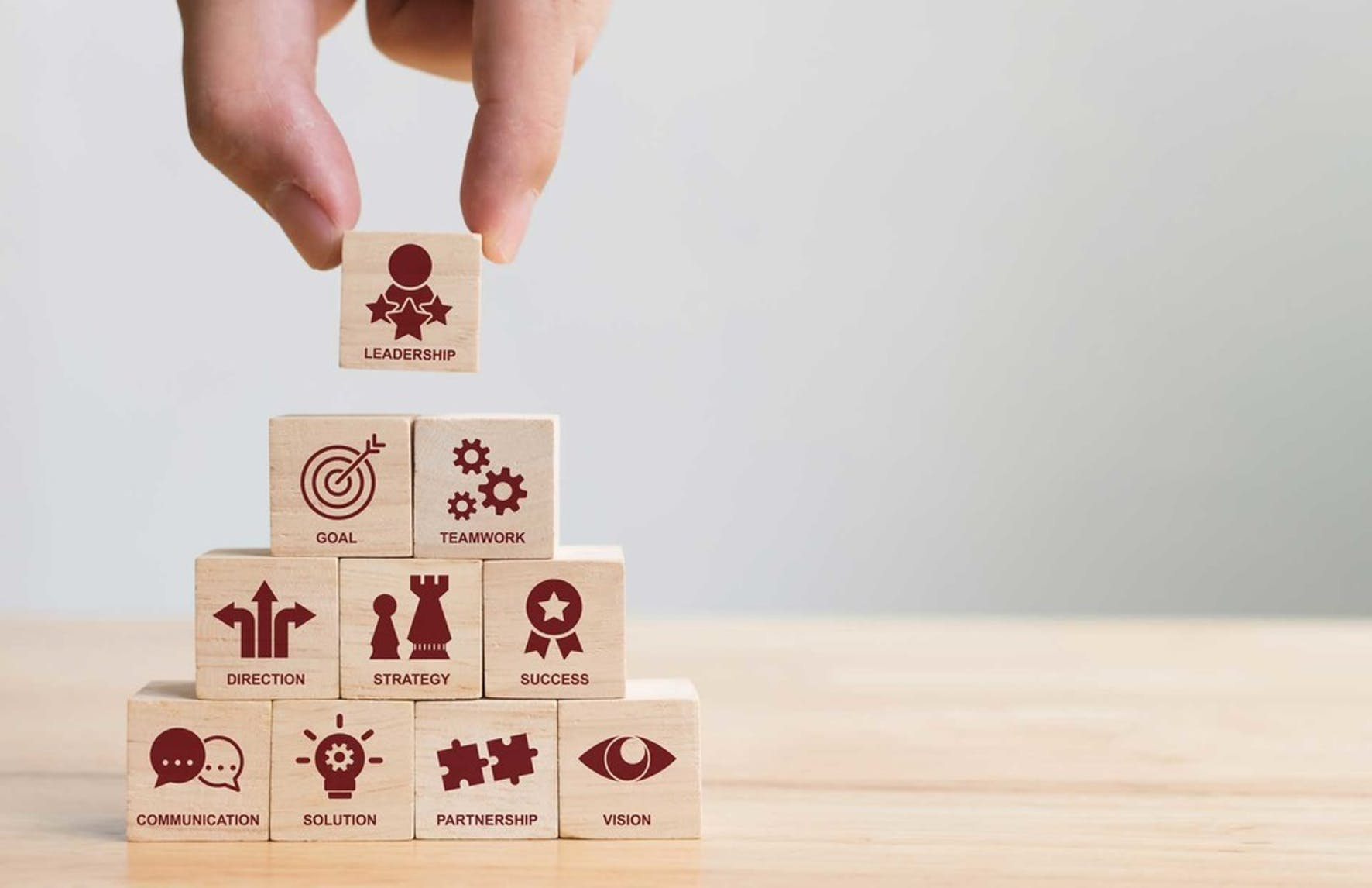A visual of building blocks describing how a business structure works when filing small busines taxes for the first time